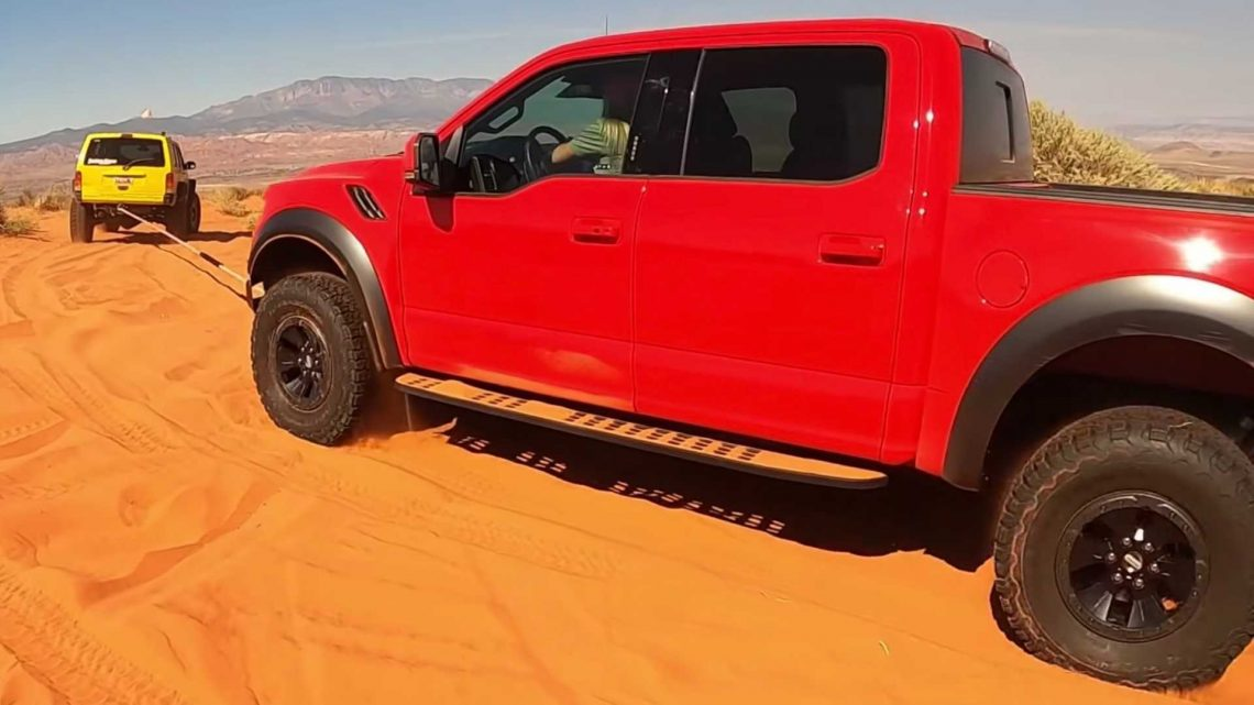 Jeep Cherokee Called To Rescue Two Ford F-150 Raptors Stuck In Sand