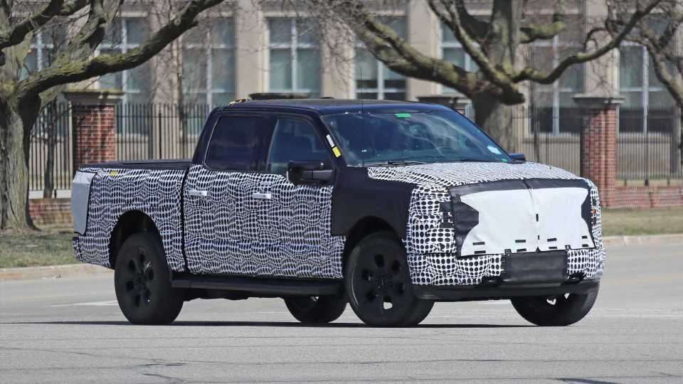 Ford F-150 Electric Pickup Shows Its Camouflaged Face In Dearborn, Michigan