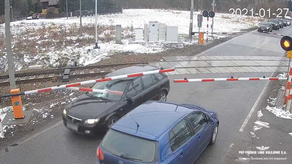 Mazda Driver Nearly Decapitated By Railroad Crossing Gate During Chase