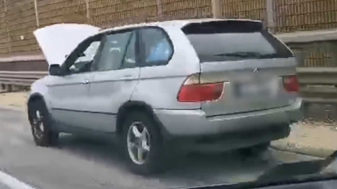 BMW X5 Caught Driving With Hood Up On Hungarian Freeway