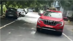 Mahindra XUV700 with new logo spotted undisguised